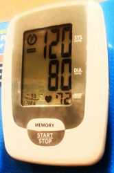 Blood pressure monitor reading 120/80 copyright American Heart Association