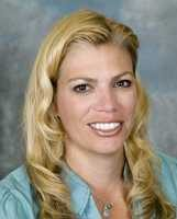 Headshot portrait of Dr. Kim Harmon, family medicine, sports medicine.