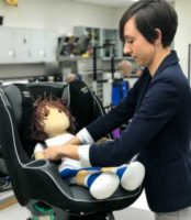 Julie Mansfield straps a doll into a car seat. Rear-facing car seats are known to protect children in front and side impact crashes, but are rarely discussed in terms of rear-impact collisions. In a new study, researchers at The Ohio State University Wexner Medical Center explored the effectiveness of rear-facing car seats in rear-impact accidents by conducting crash tests with different car seat types and features.