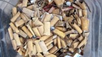 """Used Cigarette Butts"" by Indi Samarajiva is licensed under CC BY 2.0"