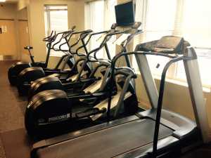 """Elliptical Stationary Bikes GVSU Winter Hall Exercise Center 2-4-15"" by Steven Depolo is licensed under CC BY 2.0"