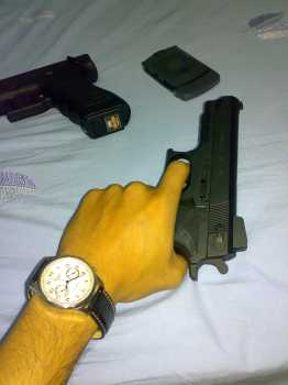 """Me holding USP gun"" by Nghị Trần is licensed under CC BY 2.0"