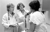 """""""Doctors with patient, 1999"""" by Seattle Municipal Archives is licensed under CC BY 2.0"""